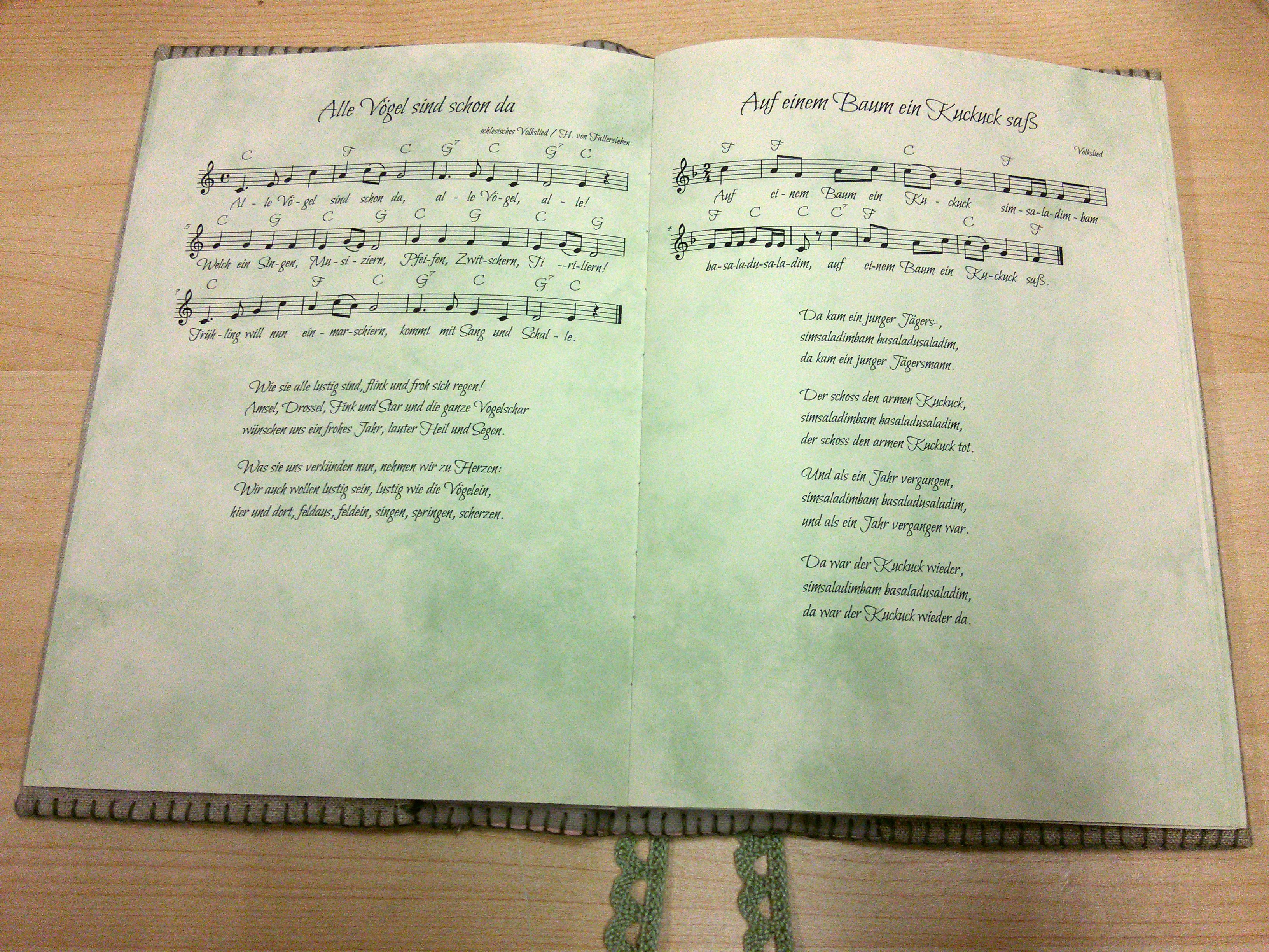 A photo of my songbook, open to show some pages with songs on them.